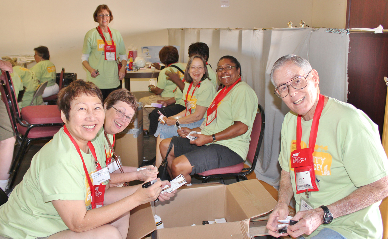 volunteers helping good360 at a aarp life50 community service day event in las