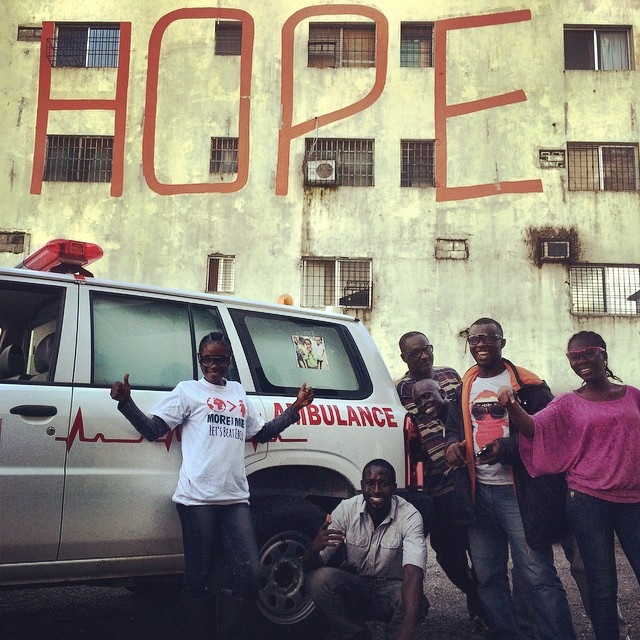 This ambulance, which takes patients from West Point to the Ebola Treatment Units, was the generous donation of philanthropist Jim Greenbaum. Posing with the ambulance is the More Than Me staff. (Instagram.com/katiemeyler,More Than Me)