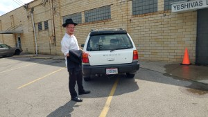 Yeshiva school with car