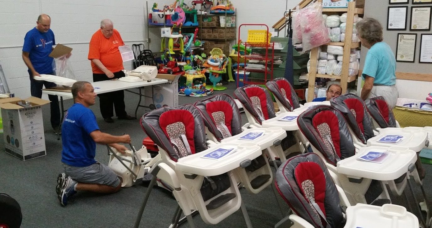 Volunteers Come Together to Give Newell High Chairs to Parents in Need